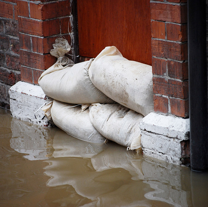 Sandbags stopping flood water getting in door