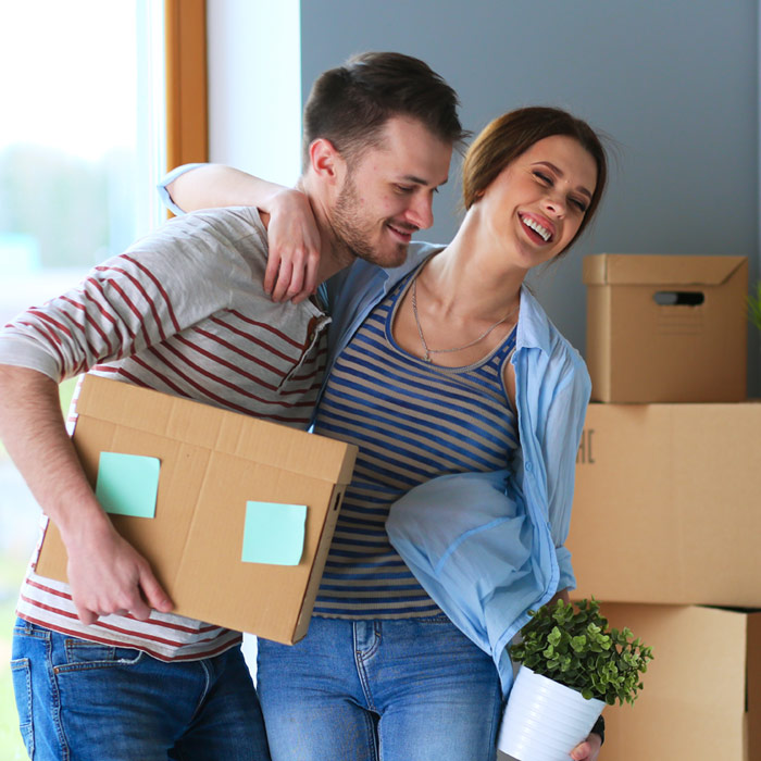 Young first time buyer couple moving into their first house