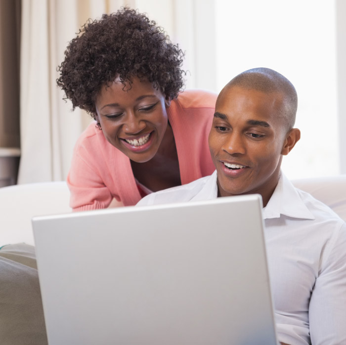 Young Couple looking at computer looking for life insurance